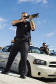 Police Officer Aiming Shotgun — Stock Photo