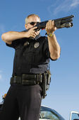 Police Officer Aiming Weapon — Stock Photo