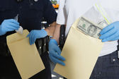 Police Officers With Evidence Envelopes — Stock Photo