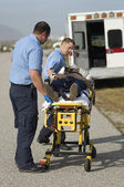 Paramedics Carrying Victim On Stretcher — Stock Photo