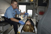 Paramedic With Victim In Ambulance — Stock Photo