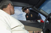 Man In Discussion With Police Officer — Stock Photo