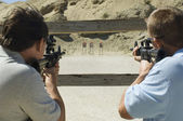 Men Aiming Rifles At Firing Range — Stock Photo