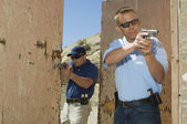 Two Officers Aiming Hand Guns At Firing Range — Stock Photo