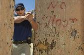 Man Aiming Hand Gun At Firing Range — Stock Photo