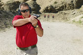 Man Aiming Hand Gun At Firing Range — Stock Photo