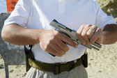 Man Loading Hand Gun At Firing Range — Stock Photo