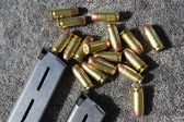 Gun Magazine And Bullets On Carpet — Stock Photo