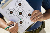 Instructor Holding Clipboard With Target Diagram — Stock Photo