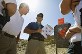 Male Instructor Holding Clipboard With Target Diagram — Stock Photo