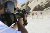 Man Aiming Machine Gun At Firing Range — Stok fotoğraf
