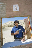 Man Holding Hand Gun At Firing Range — Stock Photo