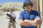 Two Men At Firing Range In Desert — Stock Photo