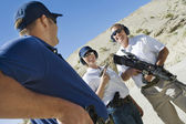 Instructor with man and woman at firing range — Stock Photo