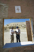 Instructor Assisting Woman At Firing Range In Desert — Stock Photo