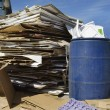 Stack Of Cardbox Boxes With Waste Bin - Stock Photo