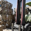 Stock Photo: Forklift And Stack Of Cardboard Boxes