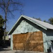 Stock Photo: Boarded Up Garage of Empty House