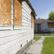 Stock Photo: Abandoned Houses With Boarded Up Windows