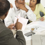 Accountant Giving Couple Bad News — Stock Photo