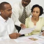 Financial Advisor Explaining Plans To Couple — Stock Photo #21963865