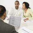 Couple Discussing Financial Plans With Male Advisor — Stock Photo #21963867
