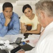 Stock Photo: Financial Advisor In Discussion With Clients