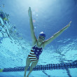 Swimmer Wearing U.S Swimsuit In Pool - Stock Photo
