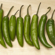 Green Chili Peppers In Row -  