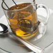 Tea Strainer Dipped In A Cup — Stock Photo