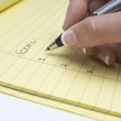 Hand Writing List Of Goals On Notepad — Stock Photo