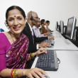 Foto Stock: Customer Service Operators Working Together In Office