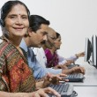 Female Customer Service Operator In Sari With Colleagues In Office — Stock Photo