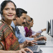 Stock Photo: Female Customer Service Operator In Sari With Colleagues In Office