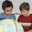 Students Examining A Globe — Stock Photo