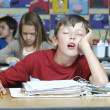 Stockfoto: Boy Sleeping In Classroom