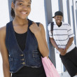 Happy Students At College Corridor - Stock Photo