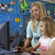 Teacher And Student Using Computer — Stock Photo