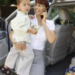 Businesswoman Carrying Son While On Call — Stock Photo