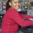 Stock Photo: Preadolescent Girl Sitting In Classroom