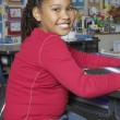 Preadolescent Girl Sitting In The Classroom — Stock Photo
