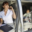 Business Woman Using Mobile Phone With Son In Car — Photo
