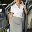 Businesswoman On Call While Standing By Car — Stock Photo