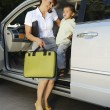 Stockfoto: Business WomUsing Mobile Phone With Son In Car