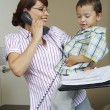 Businesswoman Looking At Son While On Call — Stock Photo