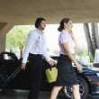 Business Couple Passing By Car — Stock Photo #21969575