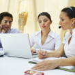 Business Using Laptop Together — Stock Photo