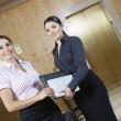 Two Business Women In Office Corridor — Stock Photo