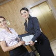 Two Business Women In Office Corridor — Stock Photo #21969897