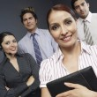 Businesswoman Standing With Colleagues In Office — Stock Photo